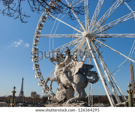 Horseman statue. Ferris wheel and Eiffel tower at background. Paris. - stock photo