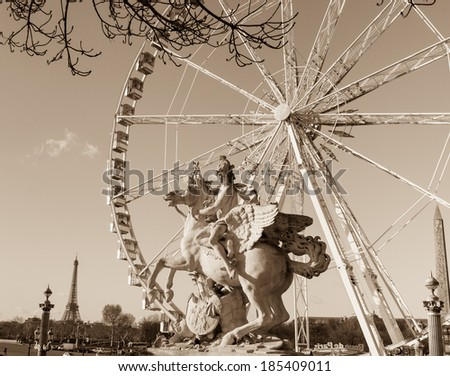 Horseman statue. Ferris wheel and Eiffel tower at background. Paris, France. Aged photo. Sepia. - stock photo