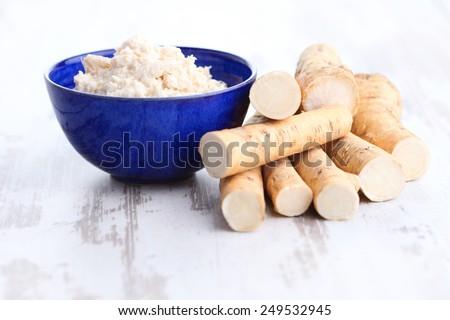 horseradish root and grated horseradish - stock photo