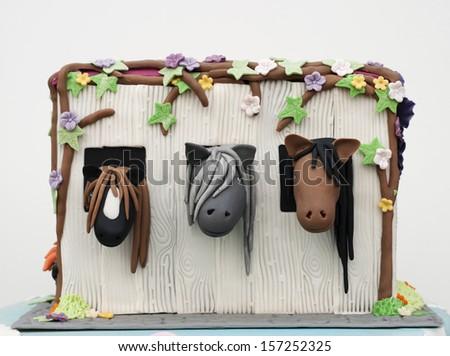 Horses in stable birthday cake - stock photo