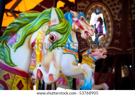 Horses on a carousel - stock photo