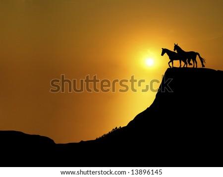 horses on mountain ridge at sunset - stock photo