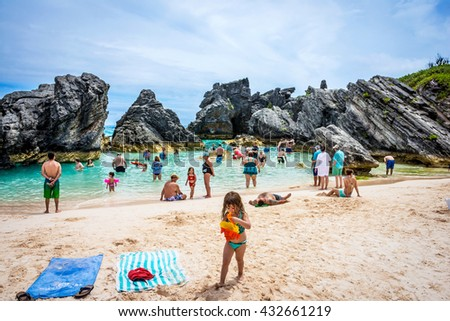 HORSESHOE BAY, BERMUDA - MAY 26 - People enjoying a rock enclosed swimming cove at Horseshoe Bay on May 26 2016 in Bermuda. - stock photo