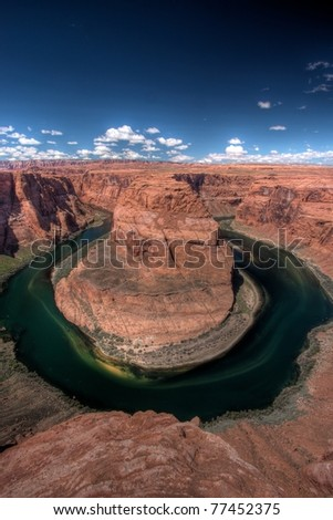 Horseshoe Bend, near Page, Arizona, USA. A dramatic meander of the Colorado river south of Glen Canyon Dam. High dynamic range image made of three blended exposures