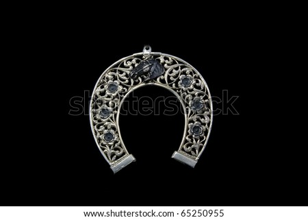 Horseshoe from silver - stock photo