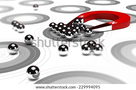 Horseshoe magnet attracting metal balls in the center of a grey target. Image concept of inbound marketing or advertising. - stock photo