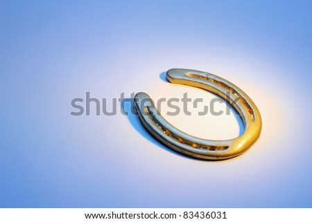 Horseshoe on Blue Background - stock photo