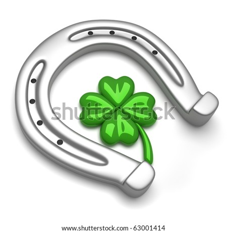 Horseshoes and clover with four leaf - stock photo