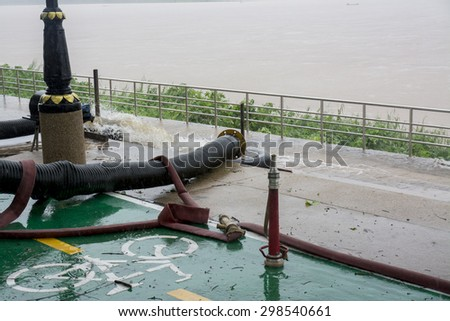Hose sent down the river. - stock photo