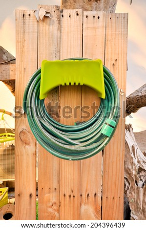 Hoses are rolled up in storage which in garden - stock photo
