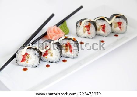 Hosomaki, tempura and red pepper. Traditional japanese sushi rolls - stock photo