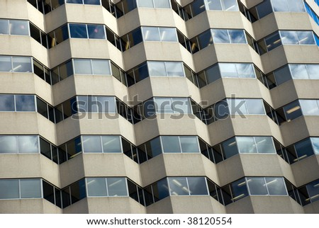 Hospital building exterior- a unique window pattern. - stock photo