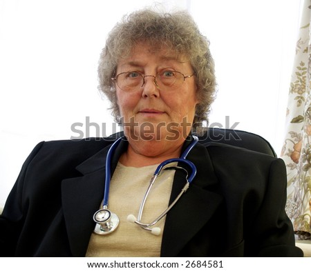 Hospital consultant giving you the once over - stock photo