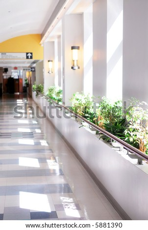 Hospital corridor leading to a reception area - stock photo