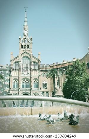 Hospital de la Santa Creu i Sant Pau - Architecture of Barcelona inscribed on UNESCO World Heritage List. Cross processed color tone - retro filtered style. - stock photo