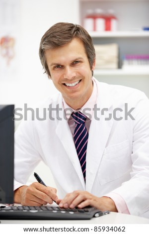 Hospital doctor at desk - stock photo