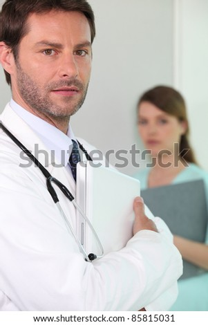 Hospital doctor with a laptop - stock photo