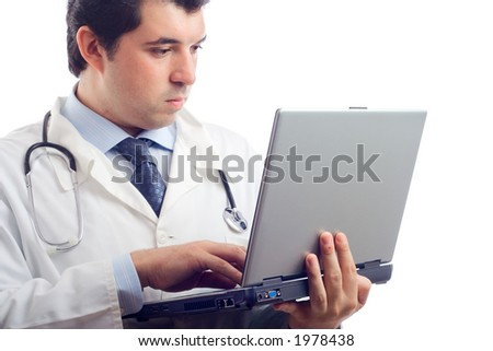 Hospital doctor working on a laptop computer