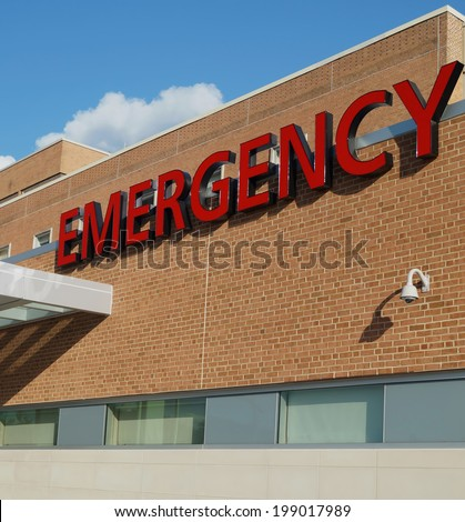Hospital Emergency Room Sign. A sign outside a hospital identifying the emergency room.                      - stock photo