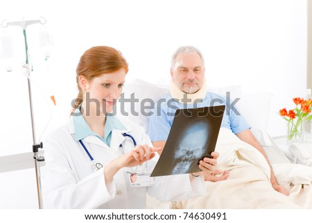 Hospital - female doctor examine x-ray senior patient