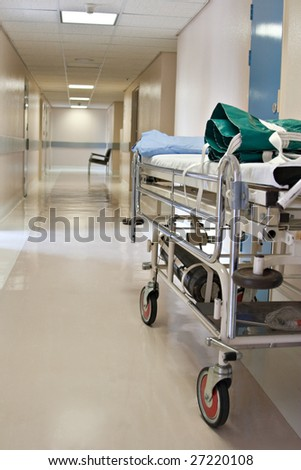 hospital hallway detailed bed in the foreground - stock photo