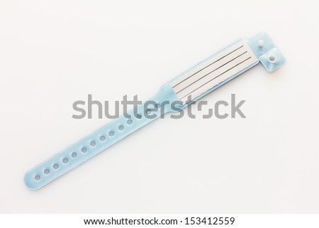 Hospital ID bracelet in blue for boys on a light background - stock photo