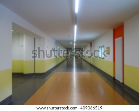 Hospital interior corridor blurred background - stock photo