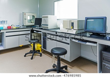 hospital lab with computer and chemistry equipment.