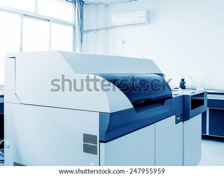 Hospital laboratories, automatic biochemical analyzer - stock photo