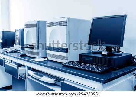 Hospital laboratories, PCR and computer. - stock photo