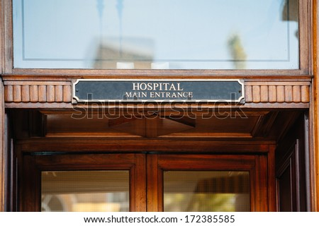 Hospital main entrance sign above hospital door - stock photo
