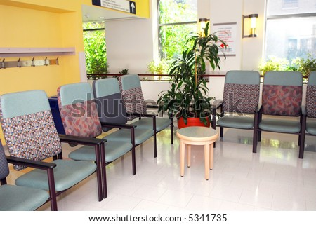 Hospital or clinic waiting room with empty chairs - stock photo