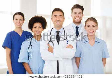hospital, profession, people and medicine concept - group of happy doctors at hospital - stock photo