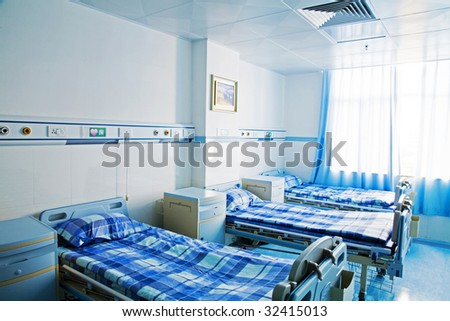 Hospital room with window and beds - stock photo