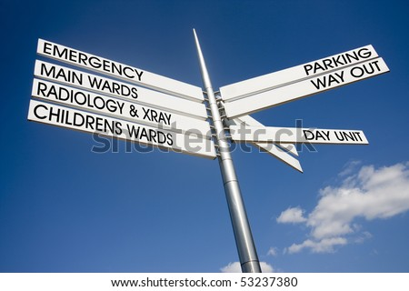 hospital signage pointing different directions for wards - stock photo