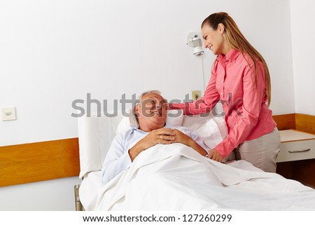 Hospital visit from the family daughter for sick senior - stock photo