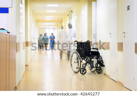 Hospital, wheelchair and unrecognizable people.