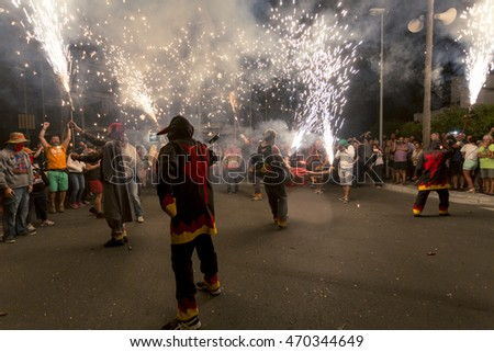 HOSPITALET DE L'INFANT - SPAIN, AUGUST -  Ball de Diables (Devils dance) Group on Correfoc (Firerun) performance within the Festa Major celebrations Aug 13, 2016 in Hospitalet de l'Infant, Spain.