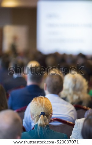 Host Speakers Standing in Front of the Audience Listening During Business Conference. Vertical Image