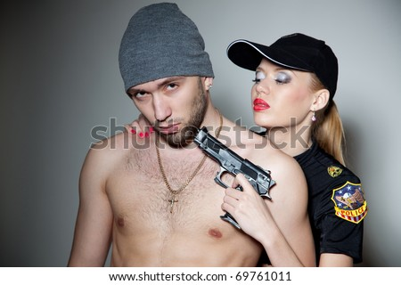 Hostage and police girl, close up studio isolated shot