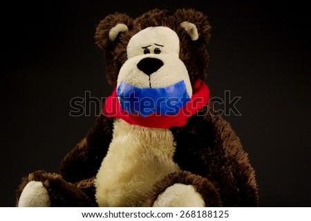 Hostage teddy bear on black background censorship - stock photo