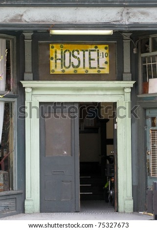 Hostel sign above a door - stock photo