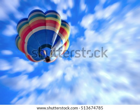 Hot ail balloon raising and gliding above the air