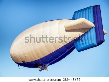 hot air airship - blimp in front of blue sky - stock photo