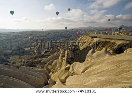 Hot Air Ballons flying on the sky of Cappadocia. Turkey. - stock photo