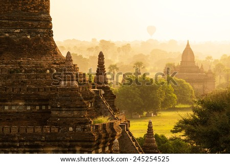 Hot air ballons over pagodas in sunrise at Bagan, Myanmar.