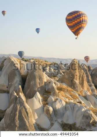Hot air balloon above a gorgeous landscape - stock photo