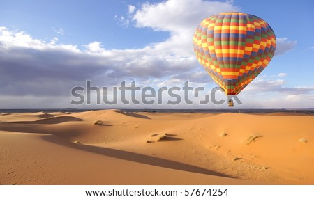 hot air balloon above the desert - stock photo