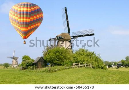 hot air balloon above the Dutch countryside - stock photo