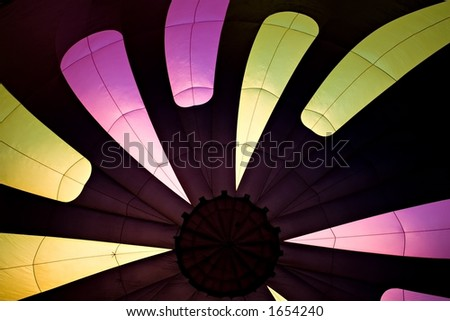hot air balloon - abstract burst of color, interior shot with envelope during inflation - stock photo